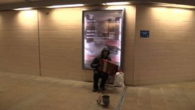 OLOMOUC, CZECH REPUBLIC, MARCH 5, 2018: Gypsy man in city begging money into a cup, authentic plays music the accordion. Gypsy man in city begging money into a stock video