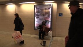 OLOMOUC, CZECH REPUBLIC, MARCH 5, 2018: Gypsy man in city begging money into a cup, authentic plays music the accordion. Gypsy man in city begging money into a stock footage