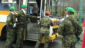 OLOMOUC, CZECH REPUBLIC, NOVEMBER 17, 2017: The elite army troop of the Czech Republic is armed into the bus, with a. The elite army troop of the Czech Republic stock video
