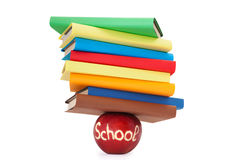 Сolor books on red apple stock photography