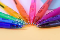 Olor pens - closeup. Ten color pens on yellow paper - closeup Stock Photos