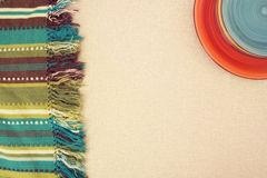 Сolored plates  and  striped green cloth, blanket Royalty Free Stock Photo