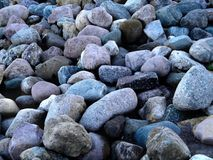 Сolored stones on the banks of the river Royalty Free Stock Image