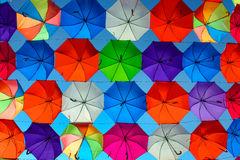Olored umbrellas in front of blue sky Royalty Free Stock Image