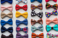 Сolorful bow ties are located in the window Stock Photos