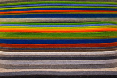 Сolorful fabric. A background with a view of a stack of colorful felt fabric Royalty Free Stock Photos