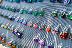 Сolorful handmade earrings. Colorful handmade earrings for sale at outside fair Royalty Free Stock Photo