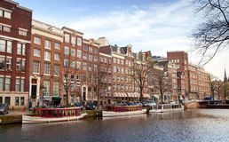 Olorful houses and pleasure boats in Amsterdam Royalty Free Stock Photo