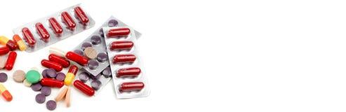 Olorful piller för Ð-¡ på vit bakgrund Fritt avst?nd f?r text Brett foto royaltyfria bilder