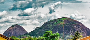 Olosunta and Orole Hills of Ikere Ekiti. Two of the many hills in Ikere Ekiti in Ekiti State Nigeria Africa. Two revered hills that are worshiped annually with a Stock Images
