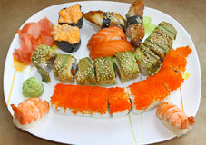 Сolourful sushi set on a white plate Stock Images