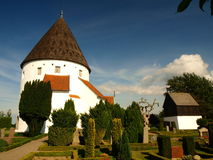 Ols kirke 2. The third church-rotunda built around the year 1250 of the Danish island of Bornholm. Near the temple is visible withered with age tree-freak Stock Image