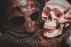 Ols rusted ancient helmet with human skull. Close-up. Ols rusted ancient helmet with human skull stock photo