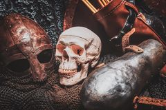 Ols rusted ancient helmet with human skull. Close-up. Ols rusted ancient helmet with human skull royalty free stock images
