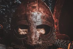 Ols rusted ancient helmet with human skull. Inside royalty free stock photos