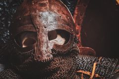Ols rusted ancient helmet with human skull. Inside stock photo