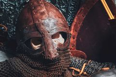 Ols rusted ancient helmet with human skull. Inside royalty free stock image