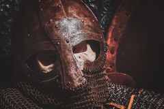 Ols rusted ancient helmet with human skull. Inside royalty free stock photography