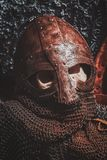 Ols rusted ancient helmet with human skull. Inside stock images