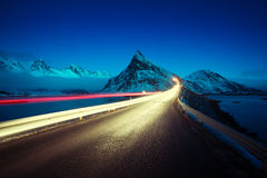 Olstind Mount and car light. Lofoten islands Stock Images