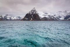 Olstind mountain peak, Lofoten, Norway. Olstind mountain peak is a landmark near Reine village, Moskenesoy island, Lofoten islands, Norway Royalty Free Stock Photos
