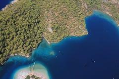 Oludeniz coastline. Aerial view of Oludeniz resort coastline looking down on beach and blue sea, Mulgla, Turkey Royalty Free Stock Images