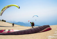 OLUDENIZ, TURKEY - July 26, 2015: Paragliders preparing for the start on the site of Mount Babadag Royalty Free Stock Images