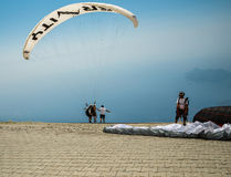 OLUDENIZ, TURKEY - July 26, 2015: Paragliders preparing for the start on the site of Mount Babadag Royalty Free Stock Photo