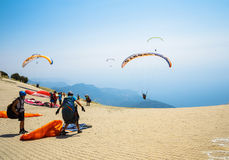 OLUDENIZ, TURKEY - July 26, 2015: Paragliders preparing for the start on the site of Mount Babadag Royalty Free Stock Image