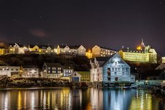 Oluf Holm, The Fisheries Museum in Alesund by night. ALESUND, NORWAY- January 05, 2018: Oluf Holm, The Fisheries Museum in Alesund by night. It is a sea port Royalty Free Stock Images