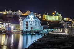 Oluf Holm, The Fisheries Museum in Alesund by night. ALESUND, NORWAY- January 05, 2018: Oluf Holm, The Fisheries Museum in Alesund by night. It is a sea port Royalty Free Stock Photos