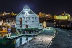 Oluf Holm, The Fisheries Museum in Alesund by night. ALESUND, NORWAY- January 05, 2018: Oluf Holm, The Fisheries Museum in Alesund by night. It is a sea port Stock Image