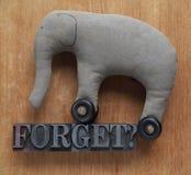 Olvide la palabra con el juguete viejo del elefante Imágenes de archivo libres de regalías