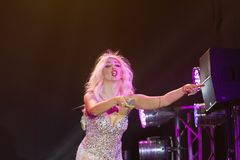 Olya Polyakova, Ukrainian pop singer, microphone to audience at her performance, Pobuzke, 15.07.2017, emotional editorial photo Royalty Free Stock Photo