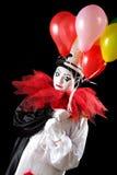 Olycklig clown med ballonger Arkivbild