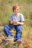 Olycklig landspojke Fotografering för Bildbyråer