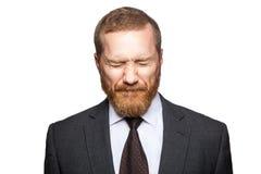 Olycklig ledsen affärsman med stängda ögon Arkivfoto