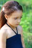 Olycklig liten flicka Arkivfoto