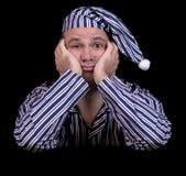 Olycklig man i pyjamas Royaltyfria Bilder
