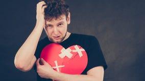 Olycklig man med bruten hjärta Arkivbilder