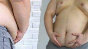 Olycklig sjukligt fet man som ser hans feta buk i spegeln, viktförlust, osäkerheter stock video