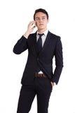 Olycklig ung Caucasian hållande mobiltelefon för affärsman Royaltyfria Foton