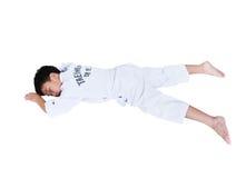 Olyckor i sportar Asiatiskt barnidrottsman nenTaekwondo ligga som är benäget Royaltyfria Bilder