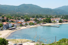 Olympiada Beach, Greece. View of Olympiada beach at Aegean Sea in Northern Greece. Mountains in the background. Photo is taken from above Stock Photos