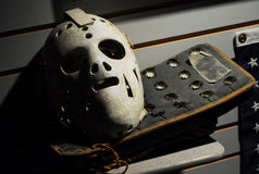 Olympian Jim Craig's Mask and Blocker. Mask and blocker belonging to 1980 US Olympic goal medalist Jim Craig on display at the New England Sports Museum at the stock images