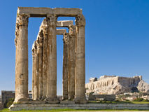 Olympian Zeus temple. Columns of Olympian Zeus temple, Remains of Olympieion temple and Acropolis on background, Athens, Greece Royalty Free Stock Images