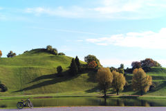 Olympiapark Lake & Hill. With bicycle Royalty Free Stock Images