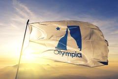 Olympiastadthauptstadt von Staat Washington des Flaggentextilstoffgewebes Vereinigter Staaten, das auf den Spitzensonnenaufgangne stockbilder