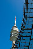 Olympiaturm tower. Low angle view of Olympiaturm tower with steel structure in foreground, Olympiapark, Munich, Germany Stock Photo