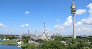 Olympic arena and swim stadium in Munich. Wide angle shot of the Olympic arena, swim stadium and TV tower located in the beautiful Olympic Park in Munich. Shot stock video footage